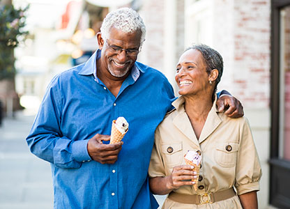 Retired couple enjoying ice cream downtown