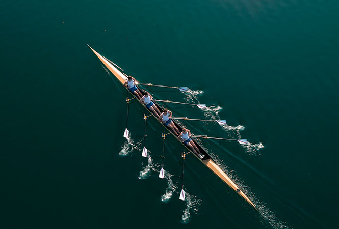 Rowing team on lake